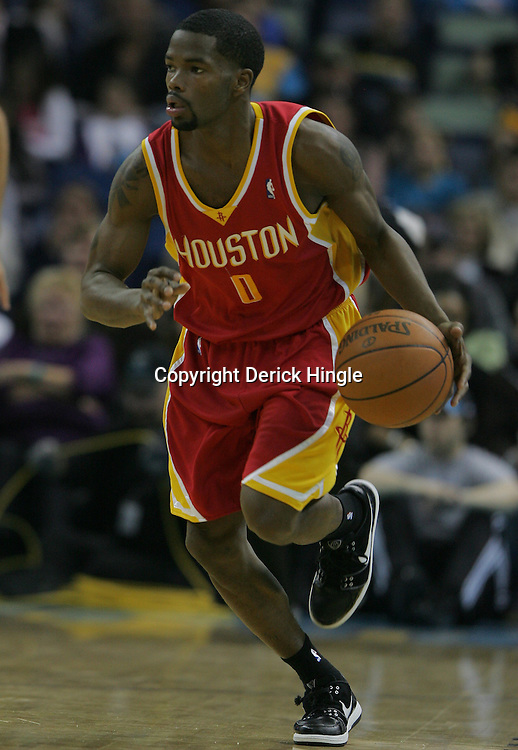 Jan 02, 2010; New Orleans, LA, USA; Houston Rockets guard Aaron Brooks (0) drives with the ball against the New Orleans Hornets during a game at the New Orleans Arena. The Hornets defeated the Rockets 99-95.  Mandatory Credit: Derick E. Hingle-US PRESSWIRE