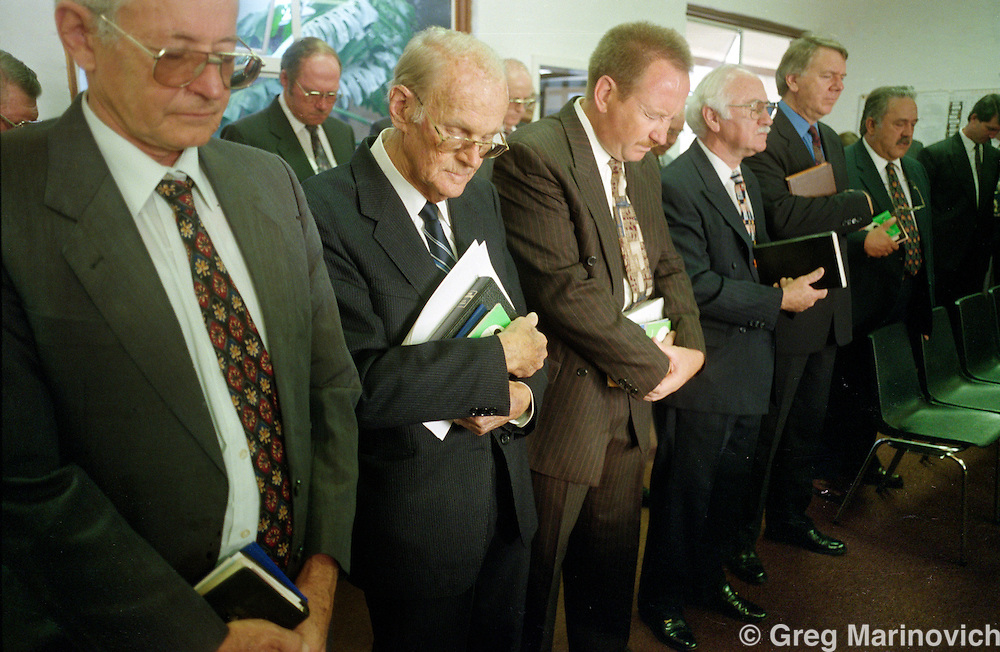 National Party cabinet members pray, Pretoria, South Africa. 1992?