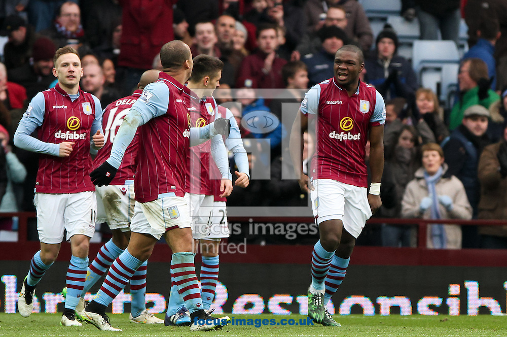 Jores Okore (right) of Aston Villa celebrates scoring his sides first goal with his team mates during the Barclays Premier League match at Villa Park, Birmingham<br /> Picture by Tom Smith/Focus Images Ltd 07545141164<br /> 07/02/2015
