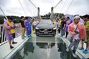 ZHANGJIAJIE, CHINA - JUNE 25:<br /> <br /> A car drives over glass-bottomed bridge for a safety test at Zhangjiajie Grand Canyon on June 25, 2016 in Zhangjiajie, Hunan Province of China. World\'s tallest and longest glass-bottomed bridge has been completed and took a global broadcast through television and internet medias to show its safety. More than thirty citizens and visitors thumped the bridge with hammer in the test event.<br /> ©Exclusivepix Media