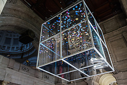 London, UK. 13 September, 2019. Sam Jacob's Sea Things has been installed within the grand entrance to the V&A museum as a Landmark Project for the London Design Festival. Designed to highlight the need to rethink the global plastics system, the installation features a large two-way mirrored cube suspended above visitors, with an animated motion graphic within created alongside Rory Cahill. It is intended to evoke powerful emotions in visitors, leaving them empowered with a better understanding of their role alongside technology and design to make the world a more sustainable place.