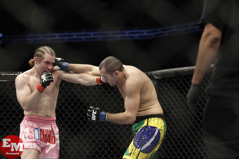 Dec 12, 2009; Memphis, TN, USA; Alan Belcher (pink trunks) and Wilson Gouveia during their bout at UFC 107 at the FedEx Forum in Memphis, TN.  Belcher won via 1st round KO.