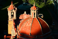 Red dome of Teatro Juarez reflects afternoon<br />  sunlight, Guanajuato Mexico