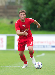 LLANELLI, WALES - Saturday, September 15, 2012: Llanelli's Lee Surman in action against Newtown during the Welsh Premier League match at Stebonheath Park. (Pic by David Rawcliffe/Propaganda)