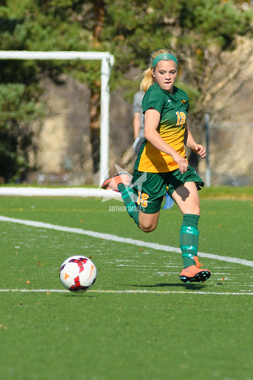 2nd year defender Cassie Longmuir (18) of the Regina Cougars in action during the Women's Soccer home game on October 2 at U of R Field. Credit: Arthur Ward/Arthur Images