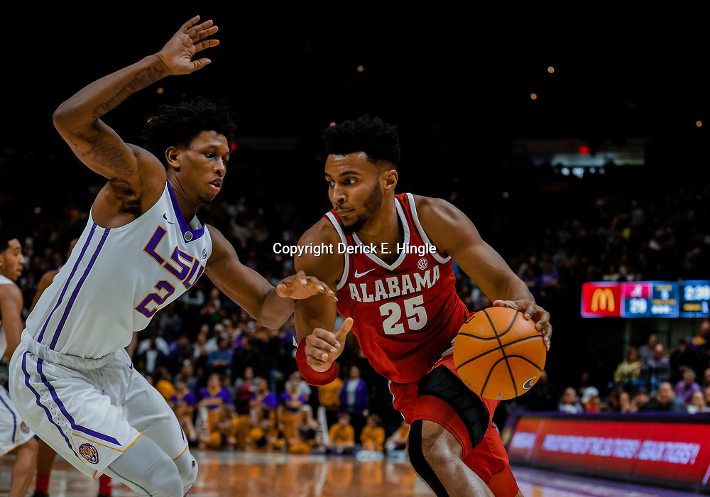 Jan 13, 2018; Baton Rouge, LA, USA; Alabama Crimson Tide forward Braxton Key (25) drives past LSU Tigers guard Brandon Rachal (2) during the first half at the Pete Maravich Assembly Center. Mandatory Credit: Derick E. Hingle-USA TODAY Sports