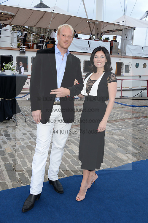 Johnnie Walker Gold Label Reserve Finale Celebration Party aboard the John Walker & Sons Voyager moored at the Prince of Wales Docks, Leith, Edinburgh, Scotland on 14th August 2013.<br /> Picture shows:-Rory Miller Mundy and Camilla Meehan.