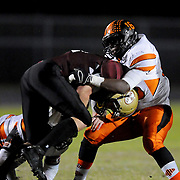 Ashley's Jesse Jewell is tackled by New Hanover's Trequan Age. (Jason A. Frizzelle)