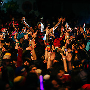 Micahel Franti and Spearhead perform to a packed crowd in Teton Village, Wyoming. Concert crowd arms in the air. Michael Franti inside the crowd.
