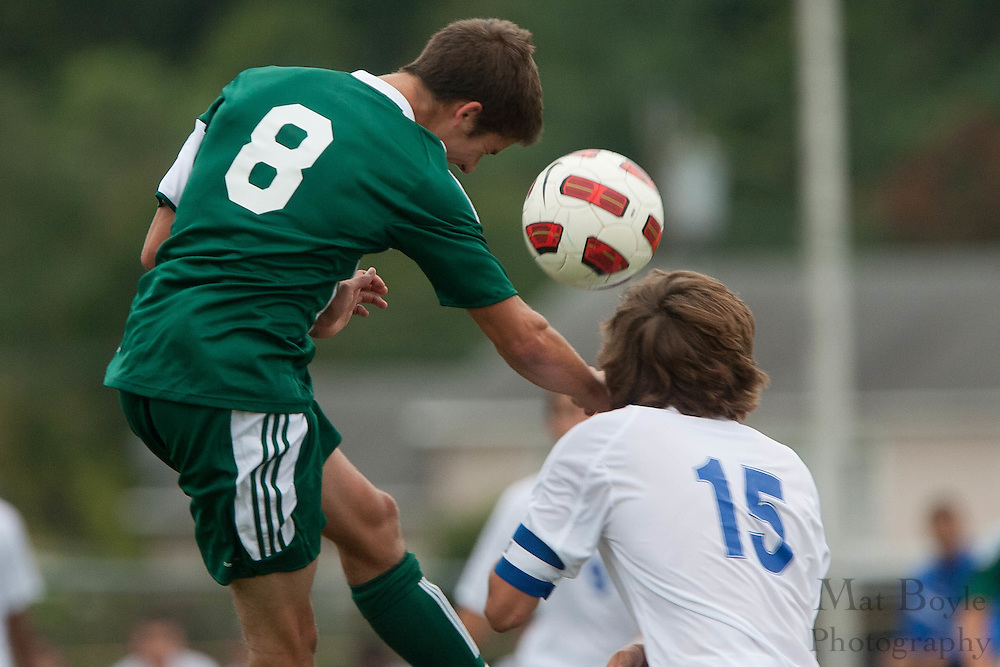 West Deptford's Kyle Redrow heads the ball off of a corner kick during the first match of the season at Sterling High School on Thursday September 8, 2011.