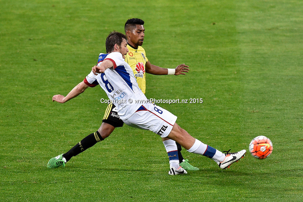 Roy Krishna (Back) of the Phoenix fights for possession with Mateo Poljak of the Jets during the A-League - Wellington Phoenix v Jets football match at Westpac Stadium in Wellington on Sunday the 11th of October 2015. Copyright Photo by Marty Melville / www.Photosport.nz