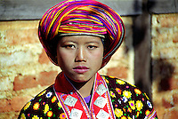 BURMA (MYANMAR),Shan State, Peinnebin. 2006. Just after herwedding ceremony in the longhouse, Ma Ko takes a moment for a portrait. She and Wan Tha will be back in the fields two days later for the Palaung sesame harvest.