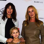 NLD/Amsterdam/20130916 -  Modeshow Jos Raak in het Conservatorium hotel, Isa Hoes met dochter Vlinder en Patty Zomer