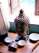 Buddha head at Satri House hotel.