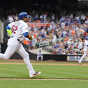 NEW YORK, NEW YORK - July 05: Yoenis Cespedes #52 of the New York Mets score the tying run on a Wilmer Flores #4 of the New York Mets sacrifice fly in the seventh inning during the Miami Marlins Vs New York Mets regular season MLB game at Citi Field on July 04, 2016 in New York City. (Photo by Tim Clayton/Corbis via Getty Images)