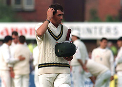 Hansie Cronje the South African Test Captain walks off after being given out to a controversial lbw decision off the bowling of England's Angus Fraser during the 5th and final Test  at Headingley today (Friday). Photo by Owen Humphreys/PA.