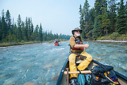 Alan Schmidt paddles a canoe on the Bow River, Banff, Alberta.