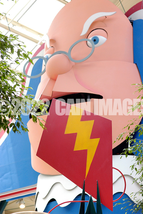 PHILADELPHIA, PA - JUNE 15: A Benjamin Franklin caricature hangs above the main court at Franklin Mills Mall June 15, 2005 in Philadelphia, Pennsylvania. (Photo by William Thomas Cain)