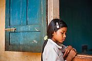 Girl in school uniform at class window (Vietnam)