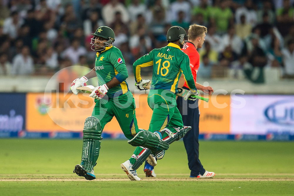 Sarfraz Ahmed and Shoaib Malik of Pakistan during the 2nd International T20 Series match between Pakistan and England at Dubai International Cricket Stadium, Dubai, UAE on 27 November 2015. Photo by Grant Winter.