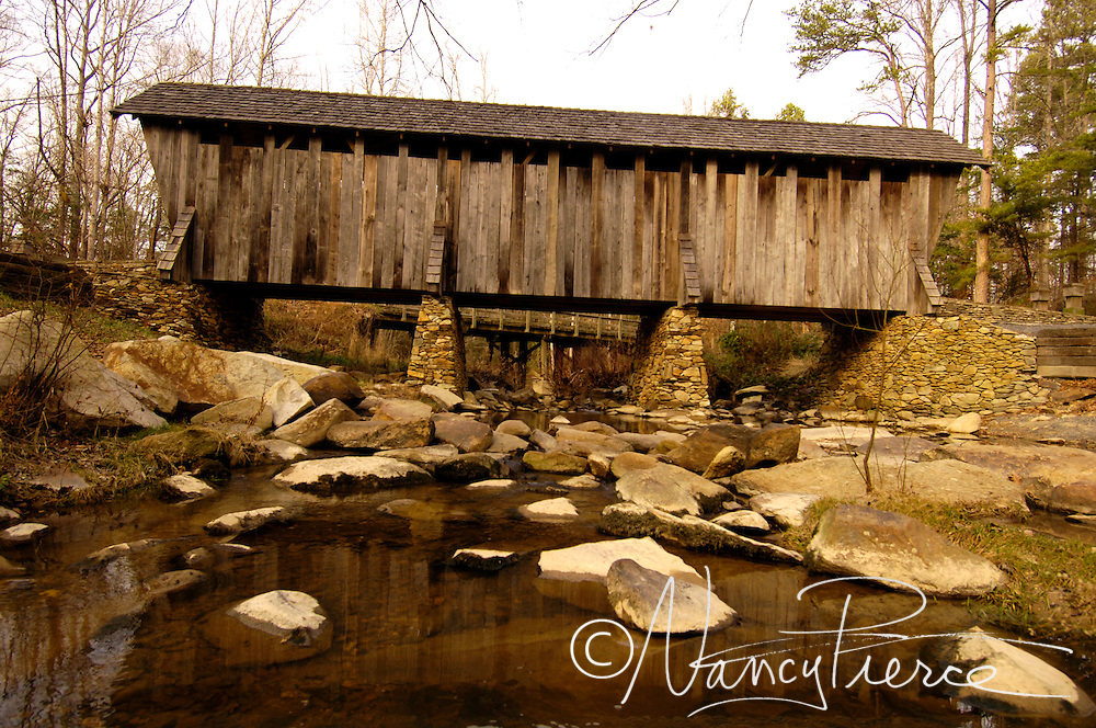 Pisgah Covered Bridge is a wooden covered bridge that spans the west fork of the Little River in the Uwharrie National Forest, Randolph County, North Carolina. It opened in 1911 at a cost of $40 to build.