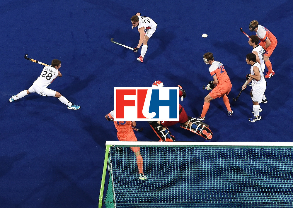 Belgium's Jerome Truyens (R) hits a shot to score a goal during the men's semifinal field hockey Belgium vs Netherlands match of the Rio 2016 Olympics Games at the Olympic Hockey Centre in Rio de Janeiro on August 16, 2016. / AFP / MANAN VATSYAYANA        (Photo credit should read MANAN VATSYAYANA/AFP/Getty Images)