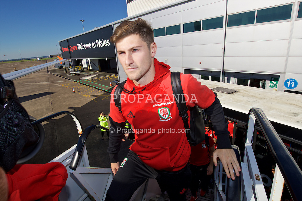 CARDIFF, WALES - Wednesday, October 5, 2016: Wales' Ben Davies boards the team plane at Cardiff Airport as the team travel to Vienna ahead of the 2018 FIFA World Cup Qualifying Group D match against Austria. (Pic by David Rawcliffe/Propaganda)