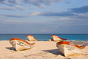 Four Red and White Lauch Boats Moored on Sand of Tulum Beach,  Mexico