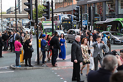 © Licensed to London News Pictures . 16/05/2015 .  The Palace Hotel , Manchester , UK . Traffic is halted in all directions at the junction of Oxford Road and Whitworth Street West as soap stars cross from the Palace Hotel to the Palace Theatre . The 2015 British Soap Awards , The Palace Hotel , Oxford Road , Manchester . Photo credit : Joel Goodman/LNP