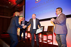 NEWPORT, WALES - Friday, May 18, 2018: Thierry Henry receives his UEFA Pro Licence Diploma from Lennie Lawrence (centre) and Wales technical director Osian Roberts (right) during day one of the Football Association of Wales' National Coaches Conference 2018 at the Celtic Manor Resort. (Pic by David Rawcliffe/Propaganda)