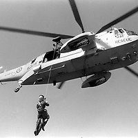 One of the RAF Search and Rescue Sea King Helicopters based at RAF Leconfield in East Yorkshire winching on board a person picked up by a lifebat