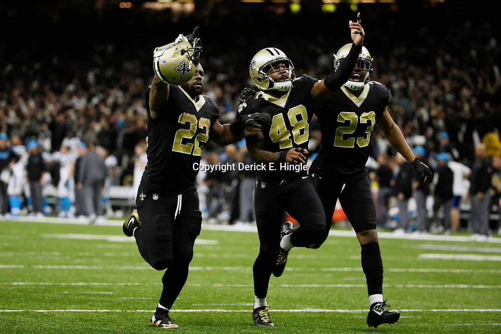 Jan 7, 2018; New Orleans, LA, USA; New Orleans Saints free safety Vonn Bell (48) celebrates with running back Mark Ingram (22) and cornerback Marshon Lattimore (23) after defeating the Carolina Panthers in the NFC Wild Card playoff football game at Mercedes-Benz Superdome. Mandatory Credit: Derick E. Hingle-USA TODAY Sports