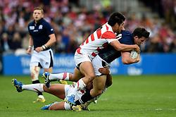 Matt Scott of Scotland is tackled to ground - Mandatory byline: Patrick Khachfe/JMP - 07966 386802 - 23/09/2015 - RUGBY UNION - Kingsholm Stadium - Gloucester, England - Scotland v Japan - Rugby World Cup 2015 Pool B.