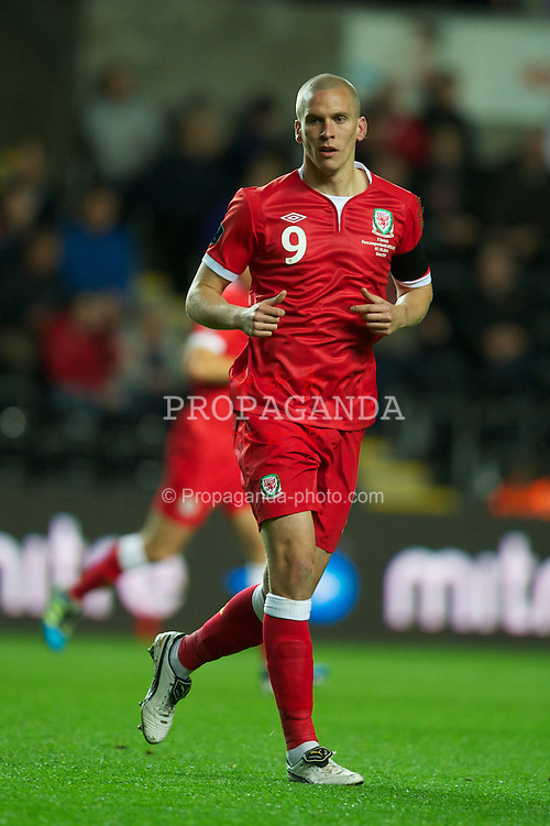 SWANSEA, WALES - Friday, October 7, 2011: Wales' Steve Morison in action against Switzerland during the UEFA Euro 2012 Qualifying Group G match at the Liberty Stadium. (Pic by David Rawcliffe/Propaganda)