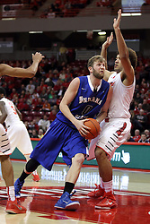 31 December 2014:  Jake Kitchell squeezes into the lane and meets Reggie Lynch during an NCAA Division 1 Missouri Valley Conference (MVC) men's basketball game between the Indiana State Sycamores beat the Illinois State Redbirds 63-61 at Redbird Arena in Normal Illinois