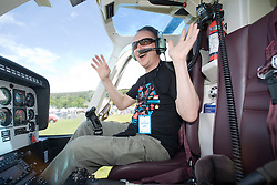 Paul Harknoll from Orbital goes up in a helicopter..Rockness, Saturday 13th June 2009..Pic © Michael Schofield. All Rights Reserved.