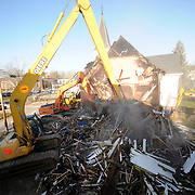 12/20/11 -- BRUNSWICK, Maine. Labbe Construction diggers compress the back side of the Unitarian Universalist Church in Brunswick on Tuesday morning. The 1885 church burned in June. Parishioners plan to break ground on a new building on the same site in summer 2012.  Photo by Roger S. Duncan.