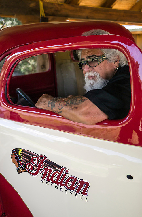 John, a custom car collector stands among his private collection of custom, vintage automobiles outside of Las Vegas, New Mexico.