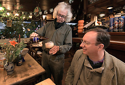 Dirk Van Dyck, proprietor of the Kulminator Bar, in Antwerp, Belgium, pours a glass of Chimay Blue, one of Belgium's most popular Trappist beers, for Brad Ringhouse, of Bayport Long Island, NY. Ringhouse, was on vacation and visited the Kulminator because he had read of it's reputation for being one of the best beer bars in the world. (Photo © Jock Fistick)