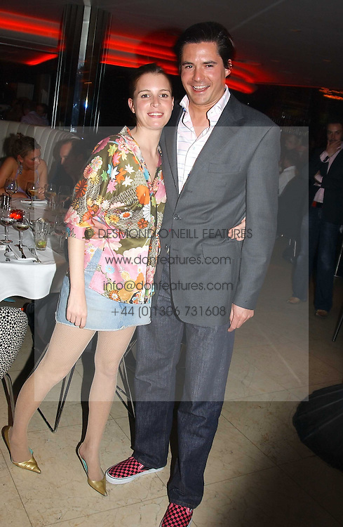 EDWARD TAYLOR and ISOBEL BUCHANAN-JARDINE at a night of Cuban Cocktails and Cabaret hosted by Edward Taylor and Charles Beamish at Floridita, 100 Wardour Street, London W1 on 14th April 2005.<br />