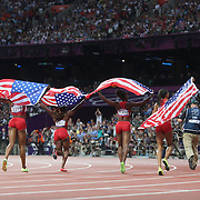 The USA Women's 4 x 100 relay team of Tianna Madison, Allyson Felix, Bianca Knight and Carmelita Jeter celebrate winning in world record time to win the Gold Medal at the Olympic Stadium, Olympic Park, during the London 2012 Olympic games. London, UK. 10th August 2012. Photo Tim Clayton