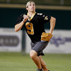 Apr 28, 2010; Metairie, LA, USA; Drew Brees (9) runs after a fly ball during the Heath Evans Foundation charity softball game featuring teammates of the Super Bowl XLIV Champion New Orleans Saints at Zephyrs Field.  Mandatory Credit: Derick E. Hingle-US-PRESSWIRE.