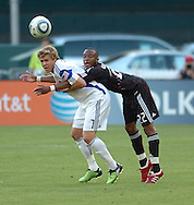 Kans CIty's Chance Myers (7) and Rodney Wallace lock arms during their team's match at RFK Stadium in Washington DC. United defeated the Wizards 2-1 to earn their first points of the season.