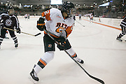 RIT's Victoria Pitawanakwat chases a puck into the corner during a game against Union College at the Gene Polisseni Center on October 3, 2014.