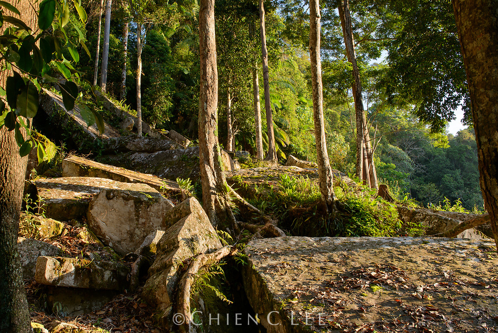 Large sandstone blocks litter a hillside at Payeh Maga in northern Borneo. Sarawak, Malaysia.