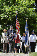Hamptonburgh, NY A veteran and American Legion member carries a wreath through Hamptonburgh Cemetery during Memorial Day ceremonies at Hamptonburgh Cemetery on May 25, 2009. This was the 142nd year flowers have been placed at veterans' graves at the cemetery.