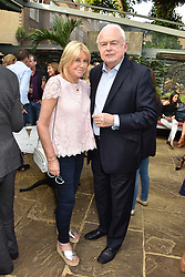 Martin Lewis and Patsy Baker at The Ivy Chelsea Garden Summer Party, Kings Road, London, England. 14 May 2018.