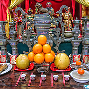 Ethnic pride and tradition  food offerings in Chinese temple in the Chinese Lunar New Year Celebration in New York Chinatown.