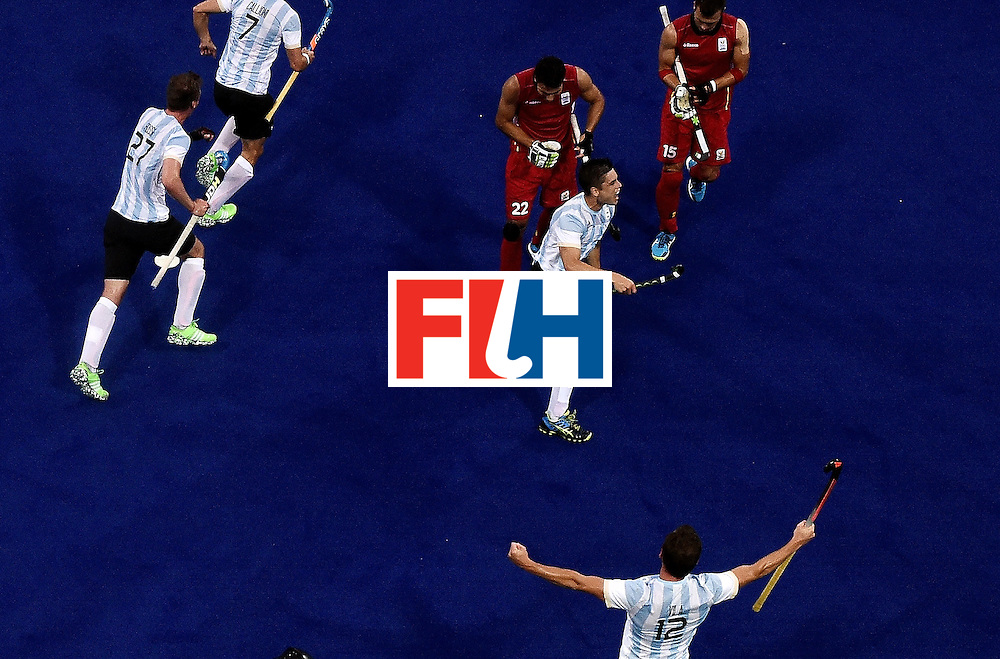 Argentina's Gonzalo Peillat (2R) celebrates after scoring a goal during the men's Gold medal field hockey Belgium vs Argentina match of the Rio 2016 Olympics Games at the Olympic Hockey Centre in Rio de Janeiro on August 18, 2016. / AFP / MANAN VATSYAYANA        (Photo credit should read MANAN VATSYAYANA/AFP/Getty Images)