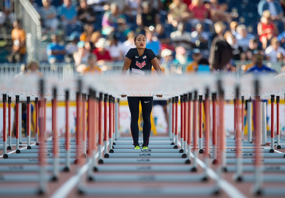 Queen Harrison, of the USA, before the start of her 100 meter hurdles heat during athletics competition at the 2015 PanAm Games in Toronto.
